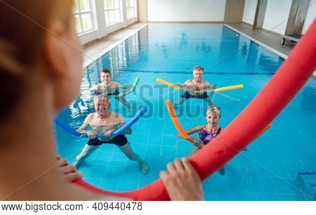 People in aqua fitness class during a physical therapy session in a physiotherapy center