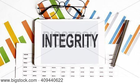 Notebook With Tools And Notes About Integrity, Concept With Charts, Business