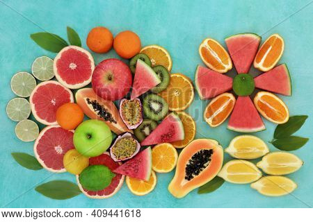 High fibre healthy fruit collection to boost the immune system very high in antioxidants, anthocyanins, lycopene and  vitamin c. Natural health care concept. Flat lay on mottled turquoise background.