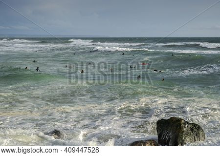 Costa Da Caparica, Portugal - April 17, 2019: Surfing In The Costa Da Caparica Beach, A Famous Place