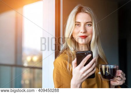 Businesswoman with smartphone, talking video call. Online chat with family, work colleagues, friends. Long distance communication. Staying connected, Social distancing, stay home, face time, internet.