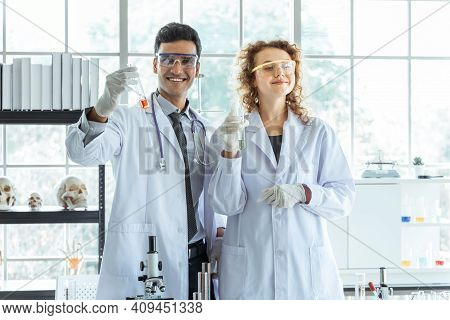 Young Successful Scientist Performing An Experiment In Modern Chemical Laboratory. Science Research