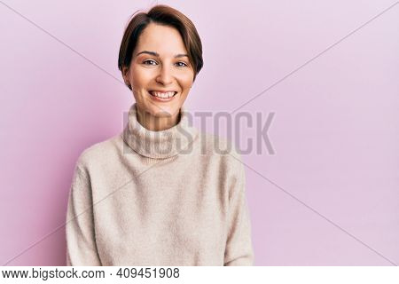 Young brunette woman with short hair wearing casual winter sweater with a happy and cool smile on face. lucky person.
