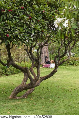 Funchal, Portugal - Sept 3, 2016: A Couple Of Young People During A Romantic Picnic In A Park In Fun