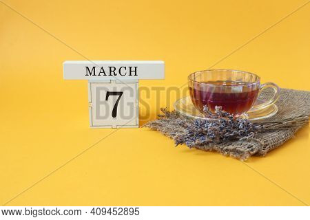 Calendar For March 7 : The Number 7 On The Cube, The Name Of The Month March In English, A Cup Of Te