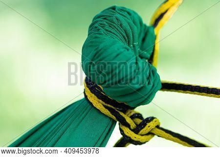 Rope Hammock Hanging On A Tree In A Backyard