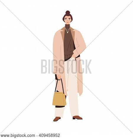 Stylish Modern Woman In Autumn Fashion Outfit. Model Wearing Coat, Sweater, Loose Pants And Handbag.