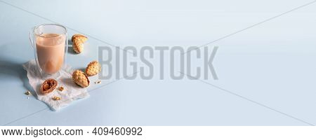 Delicious Homemade Walnut Cookies In A Bowl And Hot Coffee On Blue Background With Copy Space. Verti