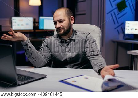 Stressed Entrepreneur Looking Confused At Laptop In The Course Of Overworking. Confused Businessman