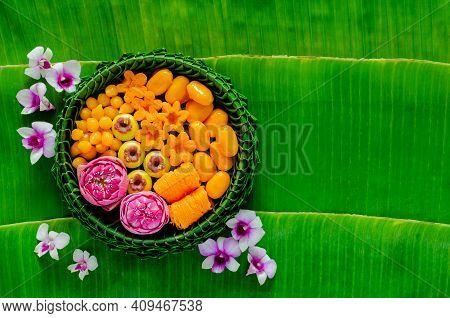 Thai Wedding Desserts On Banana Leaves Plate Or Krathong Decorate With Lotus Flower For Thai Traditi