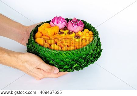 Hand Holding Partial Focus Of Thai Wedding Desserts On Banana Leaves Plate Or Krathong For Thai Trad