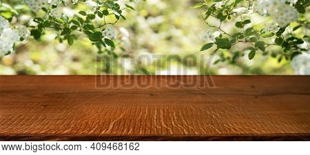 White Spring Blossoms With Empty Wooden Table. Sunny Background With Short Depth Of Field. Space For