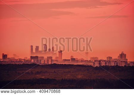 Red Sunset Over Moscow City In Foggy Haze, Russia