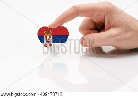 Serbia Flag. Love And Respect Serbia. A Man's Hand Holds A Heart In The Shape Of The Serbia Flag On
