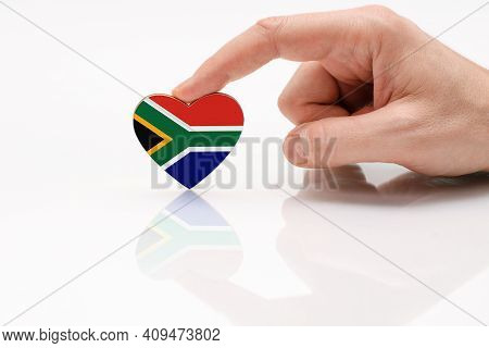 South African Flag. Love And Respect South Africa. A Man's Hand Holds A Heart In The Shape Of The So