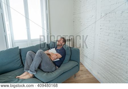 Young Man Suffering From Depression Feeling Lonely, Distressed And Hopeless Isolated At Home