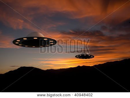 Alien spacecraft over sunset landscape