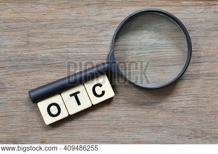 Magnifying Glass And Square Letters With Text Otc Stands For Over The Counter.