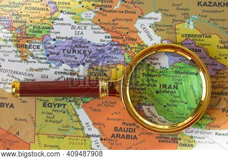 Lviv Ukraine-01 20 2021 : Iran A Map Of Asia In A Defocused Magnifying Glass, The Theme Of Travel An