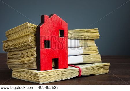 Small Wooden House As Symbol Of Real Estate And Money As Value.
