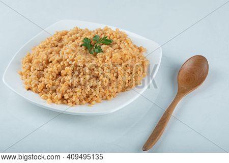 Delicious Bulgur Pilaf On A White Plate