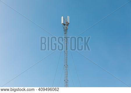 New Telecommunication Antenna On Background Of Blue Sky. Satellite Dish Telecom Network At Communica
