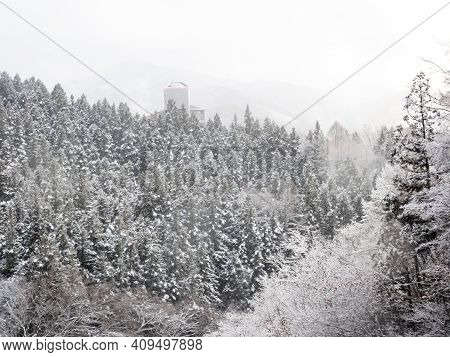 Mist And Cloud Rise From A White, Snow Covered Forest On A Mountainside Near Shiga Kogen In Yamanouc