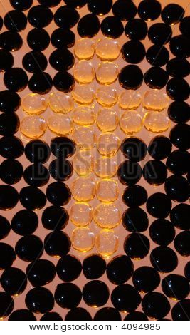 Cross With Orange And Black Beads