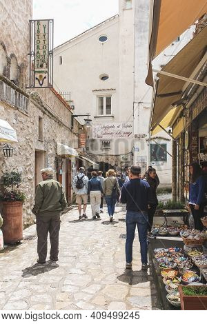 Amalfi, Italy - June 28, 2014: Tourists Exploring The Streets Of Campania On A Sunny Summer Day In I