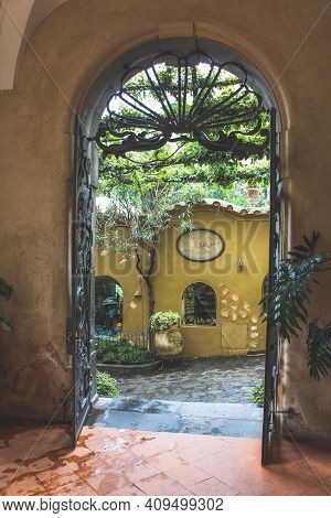 Amalfi, Italy - June 29, 2014: Entrance Of A Building With A Black Wrought Iron Door.