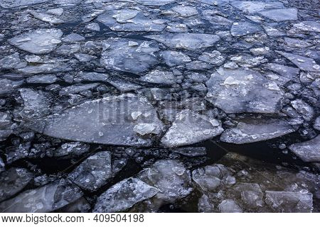 Blue Ice And Cracks On The Surface Of The Ice. Ice Texture Background. Textured Cold Frosty Surface