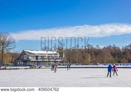 Groningen, Netherlands - February 11, 2021: Skaters In Front Of A Restaurant At The Frozen Paterswol