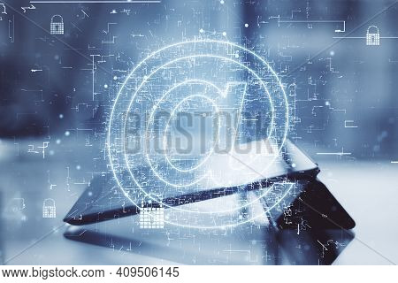 World Mail Technology With Digital Glowing Email Symbol At Digital Tablet On Table Background. Doubl