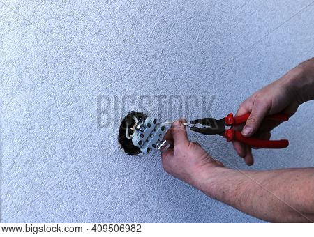 Cutting Wires With Wire Cutters When Replacing The Socket At Home, Preparing Electrical Wires With A