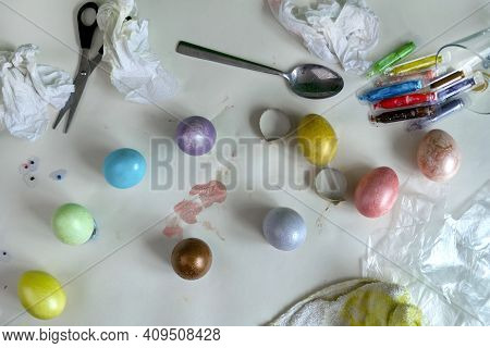 Colored Easter Eggs On Paper Gray Background With Mess On Table. Banner Of Macro Moody Minimalistic