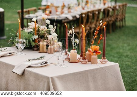 Beautiful Outdoor Wedding Decoration In City. Candles, Dried Flowers And Accessories, Bouquets And G