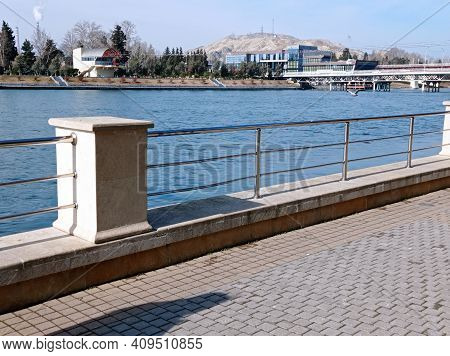 The Parks Terrace On The Back Is The Kura River . The Blue River, The Bridge And A View Of The Kura