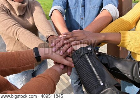 Hands Of People Of Different Nationalities Are Folded Together As A Symbol Of Unity And Peace, Close