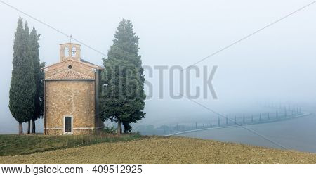 Famous Tuscany Landmark - Chapel of Madonna di Vitaleta, Misty foggy  Landscape. Tuscany, Italy, Europe