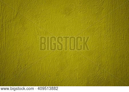 Mustard Color Plastered Concrete Wall Texture, Painted Built Structure Of Grungy Uneven Painted Plas