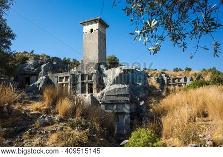 Rock tombs ruins at necropolis of Xanthos Ancient Lycia City, Turkey. Old Lycian civilization heritage architecture