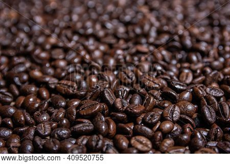 Close Up Roasted Coffee Beans Background. Stock Of Roasted Coffee Beans