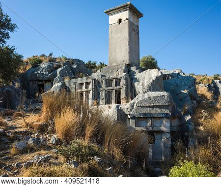 Rock tombs ruins at necropolis of Xanthos Ancient City, Turkey. Old Lycian civilization heritage architecture