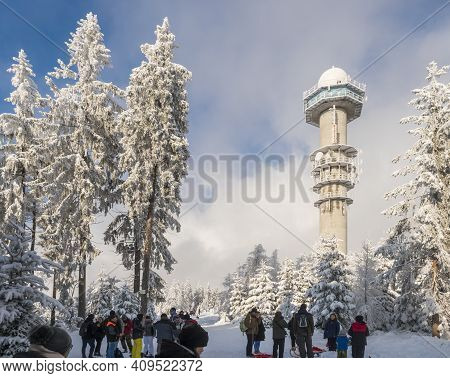 Czech Republic, Brdy Mountains, January 9, 2021: Group Of People On A Walk At Snowy Road In Winter F