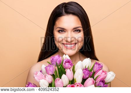 Photo Of Charming Nice Pretty Happy Woman Hold Flowers Flawless Skin Isolated On Beige Color Backgro