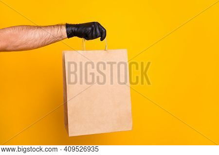 Cropped View Of Guys Hand Wearing Black Glove Giving Bringing Cafe Order Paper Package Isolated On B