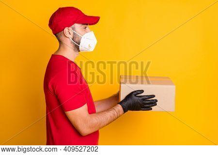Profile Side View Portrait Of Healthy Guy Wearing N95 Respirator Bringing Giving Parcel Shop Order I