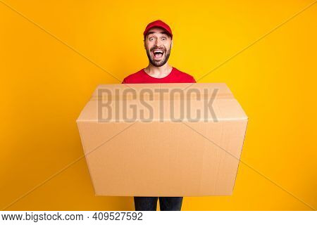 Portrait Of Nice Cheerful Guy Mailman Giving Bringing Big Parcel Fast Shipping Isolated Over Bright
