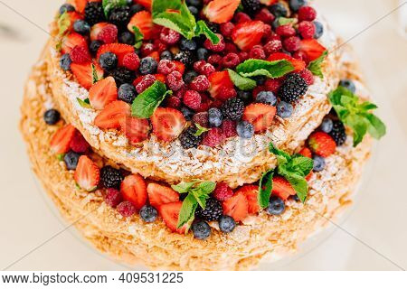 Two-tier Cake With Strawberry, Raspberry, Blueberries, Blackberries, Mint Leaves