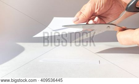 A Woman's Hand Cuts A Sheet Of White Paper With Scissors And Cuts Off The Corners. Close-up, Diy Con